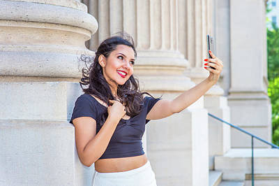 Photograph - American Teenage Girl Taking Picture Of Her Self With Cell Phone by Alexander Image