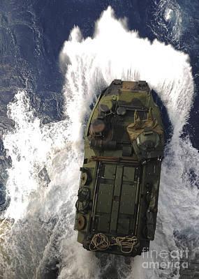Armored Vehicle Photograph - An Amphibious Assault Vehicle Exits by Stocktrek Images