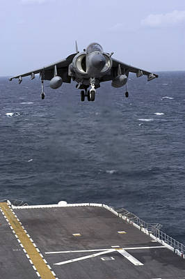 Av-8b Photograph - An Av-8b Harrier II Prepares To Land by Stocktrek Images