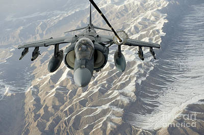 Av-8b Photograph - An Av-8b Harrier Receives Fuel by Stocktrek Images