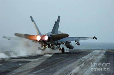 Airplane Engine Photograph - An Fa-18 Hornet Launches by Stocktrek Images