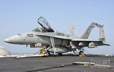 Transportation Royalty-Free and Rights-Managed Images - An Fa-18c Hornet On The Flight Deck by Giovanni Colla