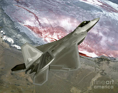 Photograph - An Fa-22 Raptor Flies A Training by Stocktrek Images