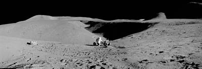 Landmarks Painting Royalty Free Images - Apollo 15 astronaut and the Lunar Rover Royalty-Free Image by Celestial Images