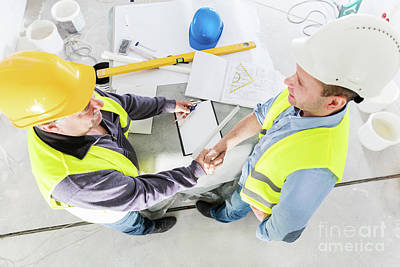 Photograph - Architect And Construction Engineer Handshake. by Michal Bednarek