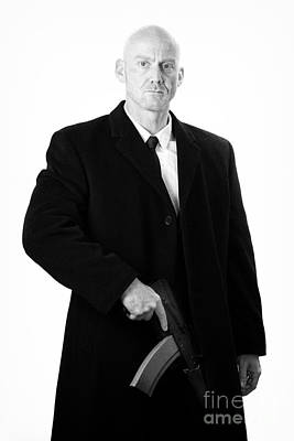 Studio Gang Photograph - Bald Headed Man Wearing Heavy Black Overcoat Holding Ak-47 by Joe Fox