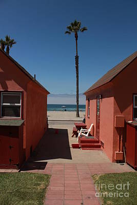 Art Print featuring the photograph Beach Cottages by Kim Pascu