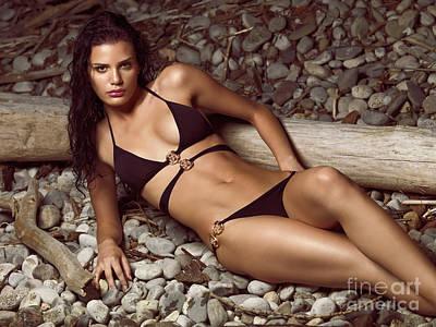 Dark Woods At Sunset Photograph - Beautiful Young Woman In Black Bikini On A Pebble Beach by Oleksiy Maksymenko