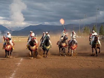 Moroccan Culture Photograph - Berber Horseman Firing Rifles by Panoramic Images