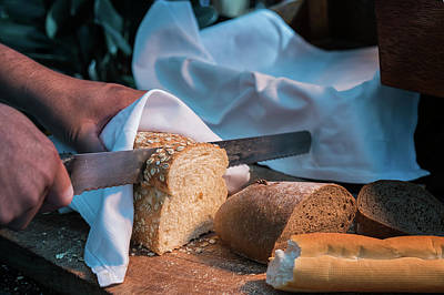 Bread Separate By Knife And Hand Art Print by Anek Suwannaphoom