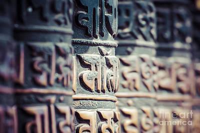 Mans Best Friend - Buddhist prayer wheels, Kathmandu, Nepal. by Mariusz Prusaczyk