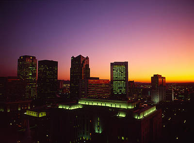 Urban Scenes Photograph - Buildings In A City At Dusk by Panoramic Images