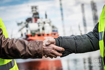 Crane Photograph - Business Handshake In A Shipyard. Shipbuilding Industry by Michal Bednarek