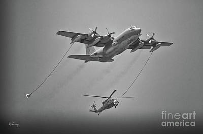 Photograph - Sikorsky Blackhawk Befriends A C-130 Aircraft For It's Thirst  by Rene Triay Photography
