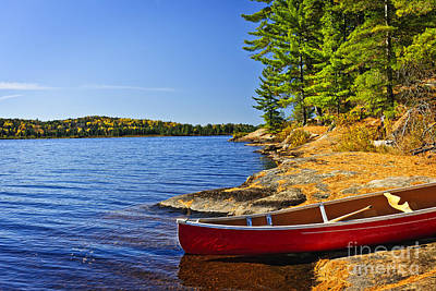 Algonquin Photograph - Canoe On Shore by Elena Elisseeva