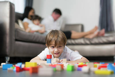 Photograph - Caucasian Boy Play Wooded Toy In Living Room In Home With His Fa by Anek Suwannaphoom