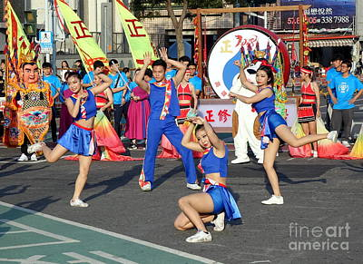 Photograph - Cheerleaders Perform During The Lantern Festival by Yali Shi