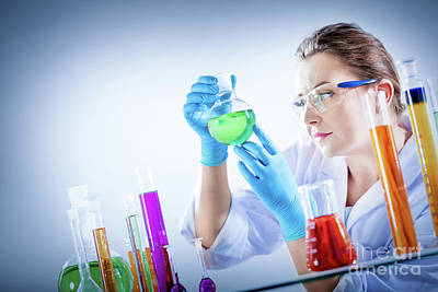 Photograph - Chemical Technologist Holds Coloured Substance In A Tube. by Michal Bednarek