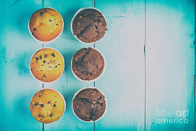 Chocolate Chip Muffins On Blue Table Art Print by Radu Bercan