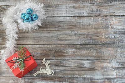 Photograph -  Christmas Decorations On A Wooden Background, Top View With Cop by Julian Popov