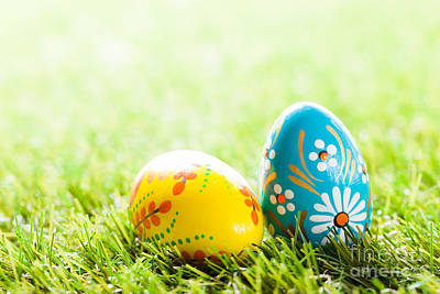 April Photograph - Colorful Hand Painted Easter Eggs In Grass by Michal Bednarek