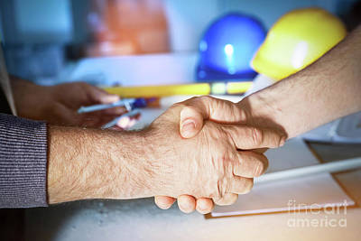 Photograph - Construction Engineers Handshake. by Michal Bednarek