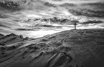 Cross On Winter Mountaintop At Sunset Art Print by Lukas Budimaier
