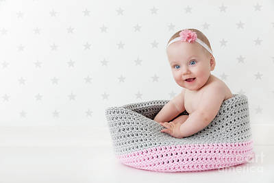 Enjoy Photograph - Cute Baby Sitting Happy And Laughing In A Woollen Basket. by Michal Bednarek
