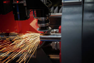 Laser Cut Photograph - Cutting Of Sheet Metal. Sparks Fly From Laser By Automatic Cutti by Anek Suwannaphoom