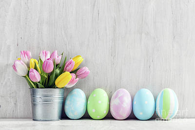 Photograph - Easter Eggs And A Spring Bouquet Of Tulips On A Wooden Table. by Michal Bednarek