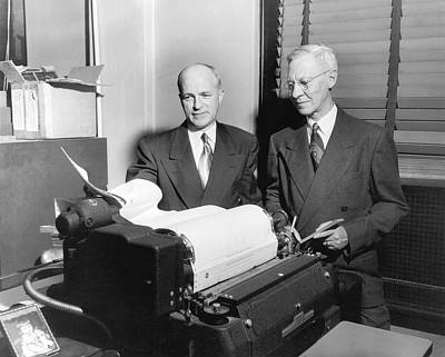 Data Photograph - Executives Viewing Data Sheets by Underwood Archives