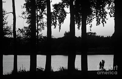 Photograph - Family Silhouetted By Lake by Jim Corwin