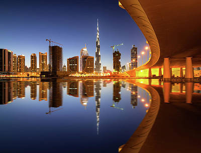 Photograph - Fascinating Reflection Of Tallest Skyscrapers In Business Bay District During Sunset. Dubai, United Arab Emirates. by Marek Kijevsky