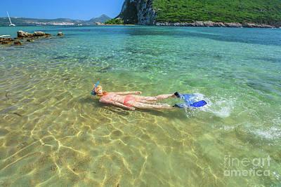 Photograph - Female Bikini Snorkeler by Benny Marty