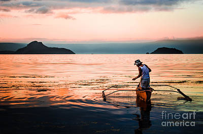 Photograph - Fisherman In The Taal Volcano Crater by Michael Arend