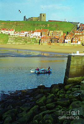 Whitby Abbey Photograph - Fishermen Returning To Whitby Harbour by Gordon Wood