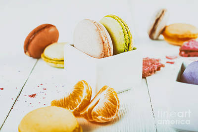 Macaroons Photograph - French Macaroons With Tangerine Slices On Wood Table by Radu Bercan