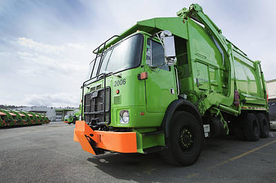 Garbage Truck Parked In A Parking Lot Art Print by Don Mason