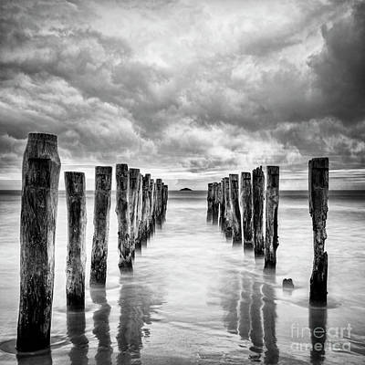 Photograph - Gathering Storm Clouds Over Old Jetty by Colin and Linda McKie