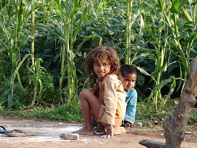 Girls In Her Own Field With Her Younger Brother Art Print by Sandeep Khanwalkar