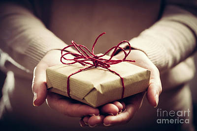 Photograph - Giving A Gift, Handmade Present Wrapped In Paper by Michal Bednarek