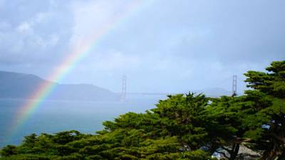 Photograph - Golden Gate Bridge By Rainbow by Alex King