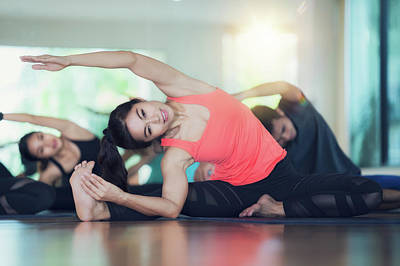 Photograph -   Group Of Yoga Exercise And Class In Fitness Center by Anek Suwannaphoom
