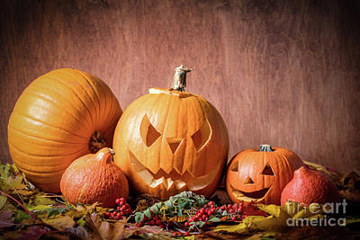 Scary Photograph - Halloween Pumpkins, Carved Jack-o-lantern In Fall Leaves by Michal Bednarek