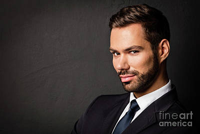 Photograph - Handsome Young Businessman Portrait On Black Background by Michal Bednarek