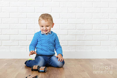 Focus Photograph - Happy Child Boy Playing With Wooden Toys On The Floor In Home. by Michal Bednarek