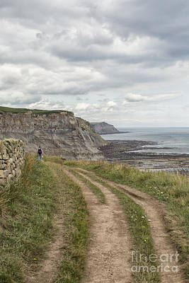Photograph - Hiker On Coastal Path In North Yorkshire by Patricia Hofmeester