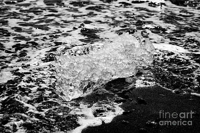 Bergy-bit Photograph - Ice Washing Up On Black Sand Beach At Jokulsarlon Iceland by Joe Fox