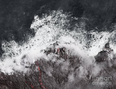 Volcano Photograph - Kilauea Lava Enters The Ocean Expanding Coastline.   by Dani Prints and Images
