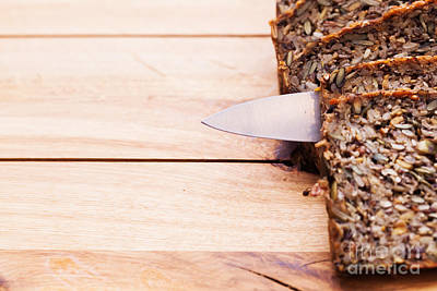 Baked Photograph - Knife In Wholemeal Bread On Wooden Table by Michal Bednarek